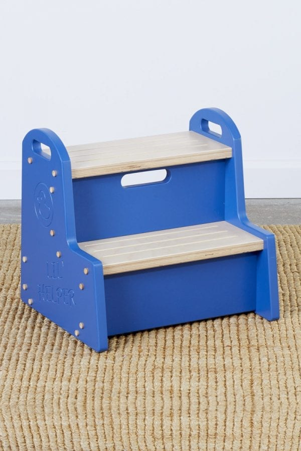 """a wooden step stool for kids with blue sides bearing a duck logo above the words """"Lil Helper"""""""