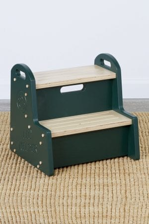 "a wooden step stool for kids with dark green sides bearing a duck logo above the words ""Lil Helper"""