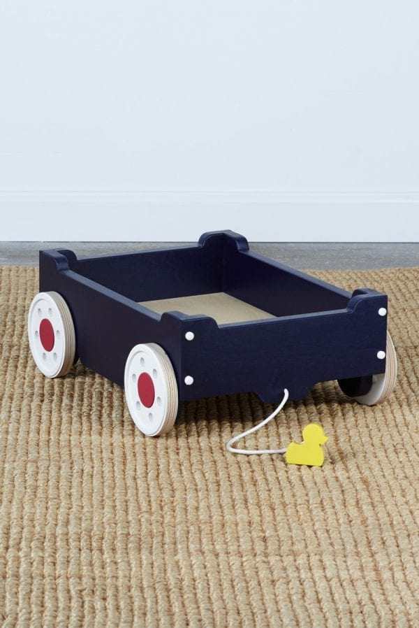 empty navy blue kids' wagon with white wheels and featuring a pull-along string with a small duck for a handhold