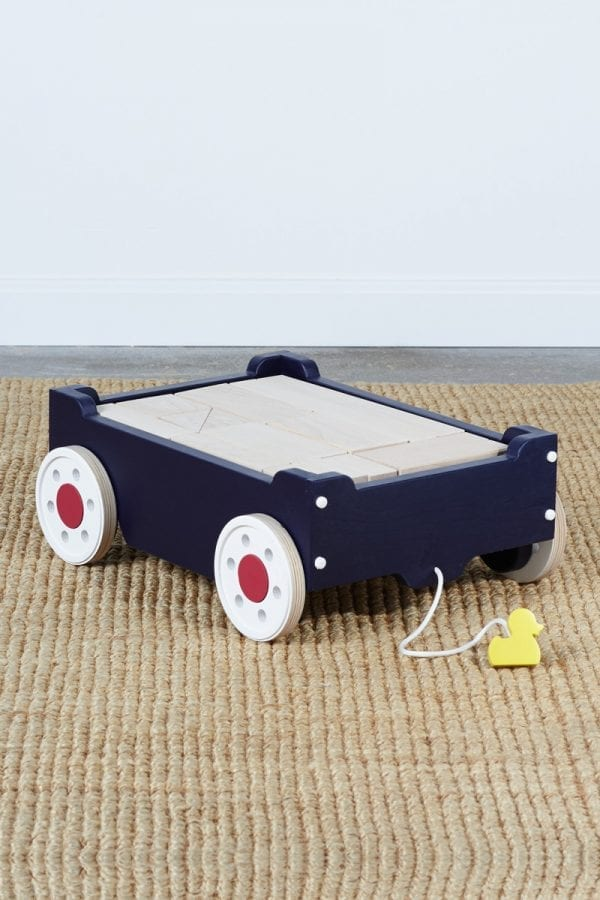 navy blue kids' wagon with white wheels containing wood blocks and featuring a pull-along string with a small duck handhold
