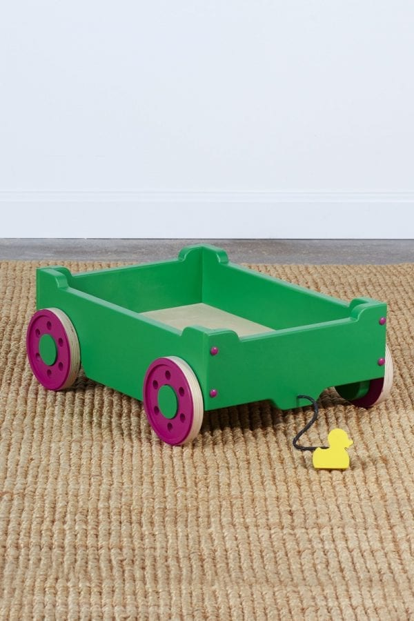 empty green kids' wagon with purple wheels and featuring a pull-along string with a small duck handhold